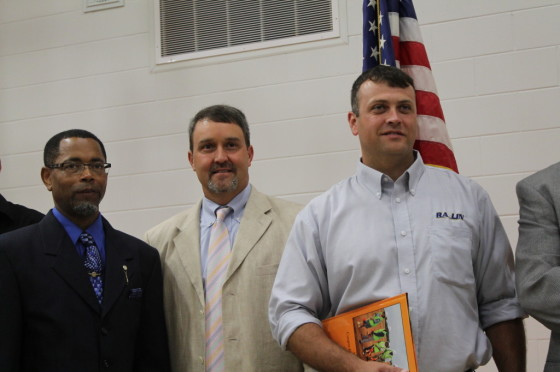 At the new Cooper Carver Elementary School ribbon cutting ceremony, Terrell County Board of Education Chairman, Ray C. Moses chats, with Ben Garrett, President of RA-LIN and Associates, the construction management firm, and Andrew Stewart, RA-LIN's Project Manager.